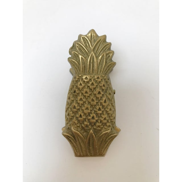Cute brass pineapple clip. The perfect desk accessory. So fun!