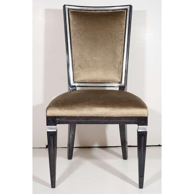 Pair of neoclassical style chairs with Gustavian design in walnut with an ebony finish and with antique silver leaf...