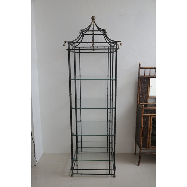 Superb Faux Bamboo Metal Pagoda Etagere with four glass shelves and little bells hanging from the top.