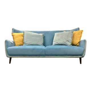 Modern Blue Sofa & Yellow Pillows