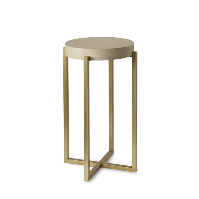 A refined accent table from the Monarch Collection from Century Furniture. A cream faux shagreen top sits upon a satin...