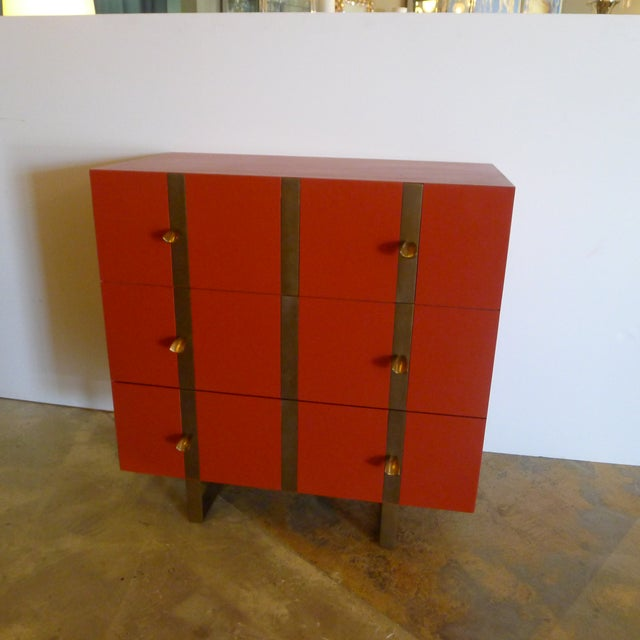 Paul Marra three-drawer banded chest in satin lacquer, Benjamin Moore Spanish Red (1301), inset smooth iron band finished...