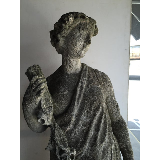 Early 20th century carved stone statue.