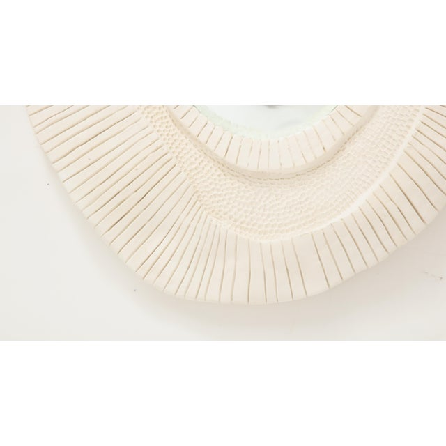 This plaster mirror, features an asymmetrical frame with beautiful detail and texture. The center is a convex mirror. This...
