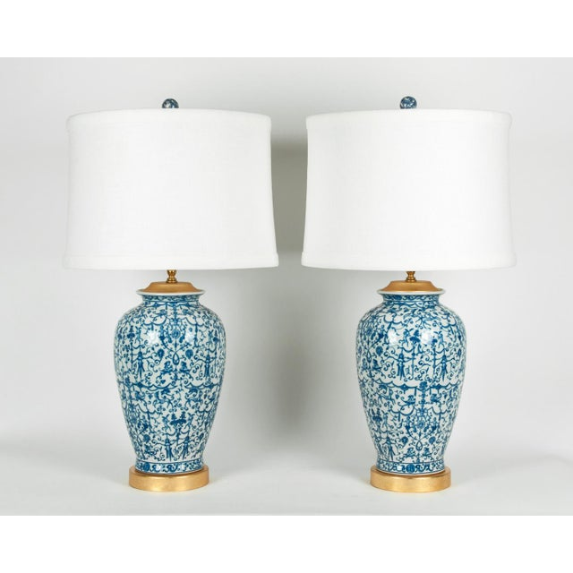 A pair of porcelain table or task lamps with gold-plated top and wooden gold-plated base. Excellent working condition....