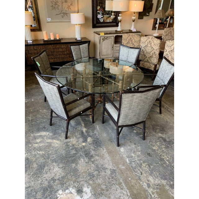 Nice McGuire dining table and chairs. Neat black and white. 66l. 66w. 39 h. Table 39h. 24 w. Seat h 18.5. 6 chairs