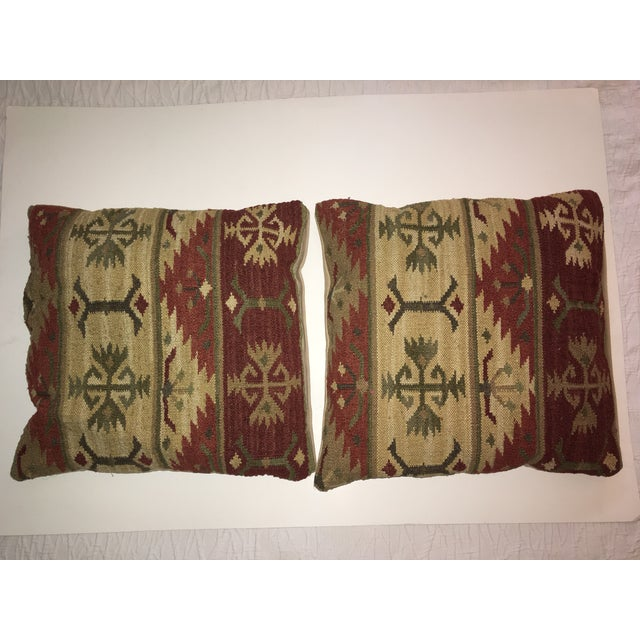 Pair of vintage Kilim pillows, with down and feather inserts.