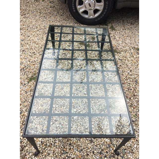 Custom Iron & Glass Coffee Table. Hand forged by La Forge Francaise, iron straps holding a piece of glass. One small chip...
