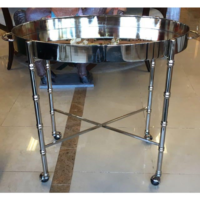 Mid Century chrome bar cart. Large oval tray on faux bamboo rolling stand. The tray has a smokey mirror surface and tall...