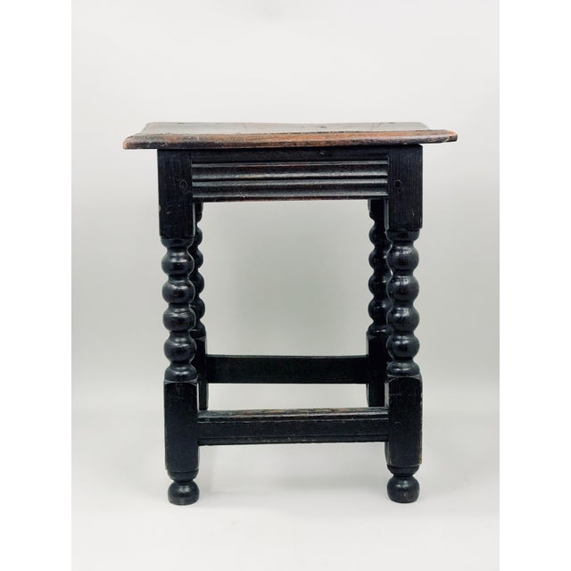 Early 19th century English oak stool with turned legs and stretchers. Perfect for use as astool or small drink table. Has...