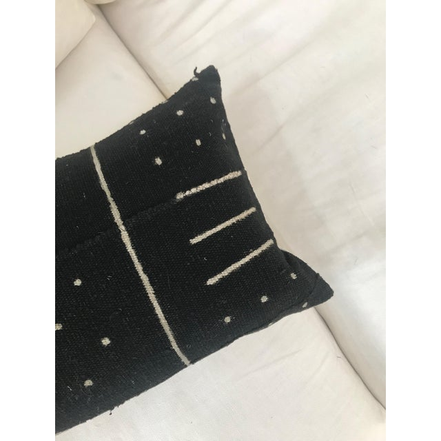 One of a kind pillow made from authentic mud cloth handmade in Africa, with canvas backing, invisible zipper, and feather-...
