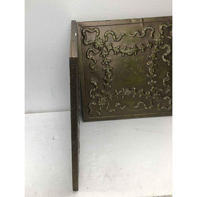 Bronze colored tin panels with a floral ribbon design. Priced as a pair. These tiles are made of antique salvaged tin...