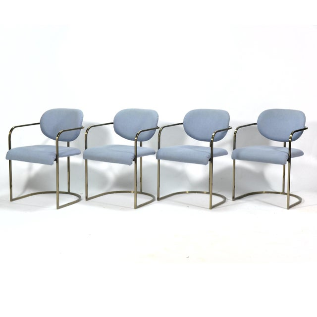 This set of armchairs by D.I.A. (possibly a Milo Baughman design) have frames of steel with an antiqued brass finish which...