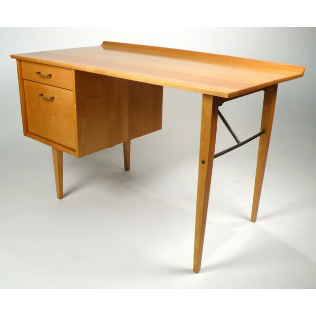 Solid maple desk with brass stretcher and handles manufactured by Murray furniture and designed by Milo Baughman. This...