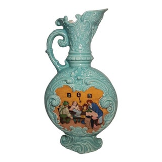 Vintage Figural Relief Pitcher With Handle For Sale