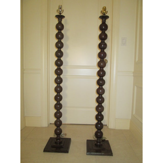 These gorgeous floor lamps from Jamie Young have a hefty metal construction and a beautiful bronze finish. These lamps...