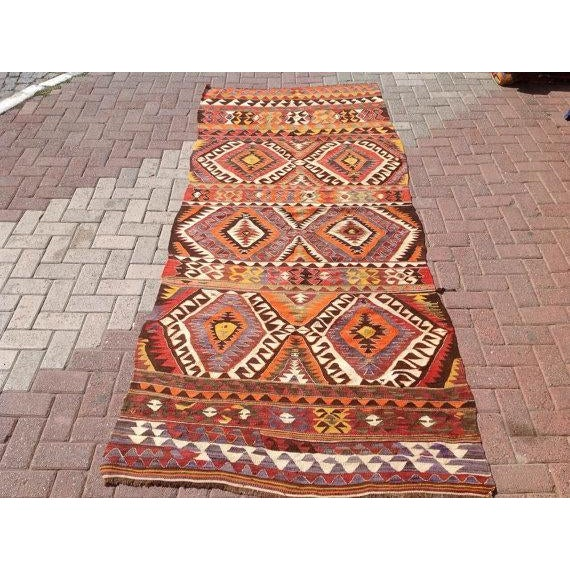 This beautiful vintage handwoven kilim is approximately 60 years old. It is handmade of very fine quality handspun wool in...