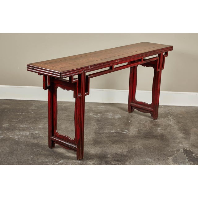 An 18th century Chinese altar table in elm with key pattern from Shanshi. Red lacquer finish with double-faced top.