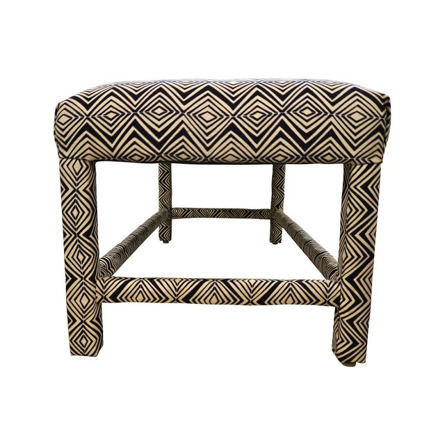 1960s upholstered bench in the style of Milo Baughman. This piece has been newly upholstered in geometric patterned navy...
