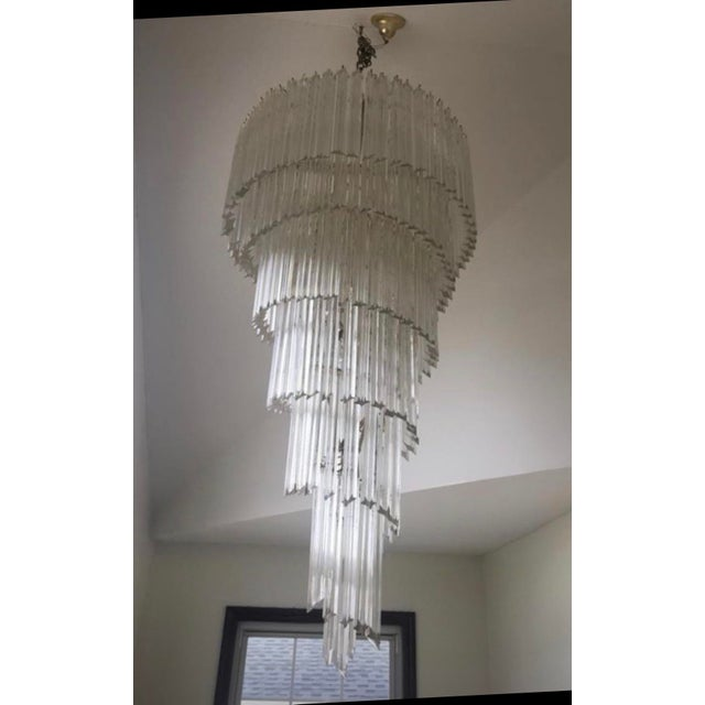 For sale is a Stunning vintage Murano glass chandelier. This is a Grand foyer chandelier when assembled 5 ft length. Great...
