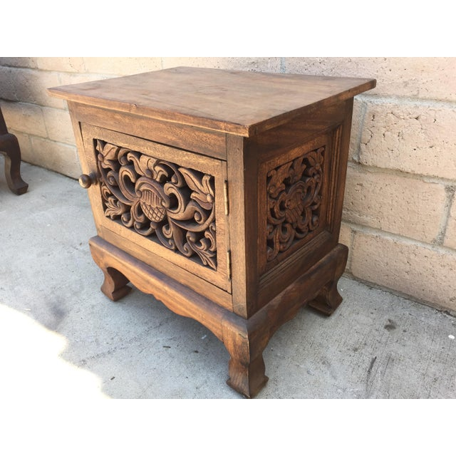This asian inspired carved cabinet has carved panels in the door and sides. It make a nice accent cabinet or side cabinet.