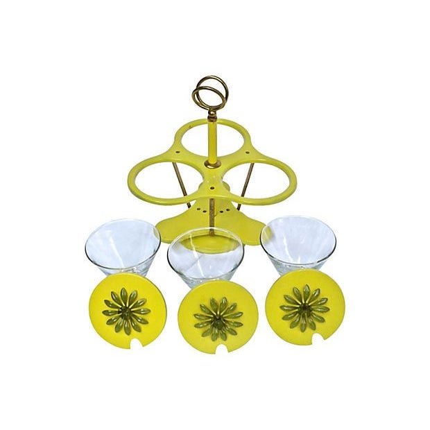 This 1960s, lazy susan rotating condiment tray features Mid-Century Modern style glass condiment dishes and yellow painted...