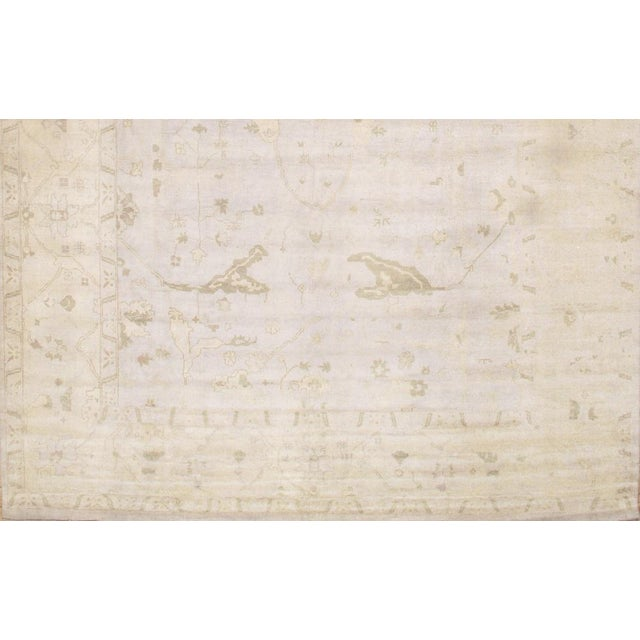 Turkish OUSHAK DESIGN from Pasargad NY. Handmade Hand-knotted. Lamb's wool on a wool foundation. This rug has a dense,...