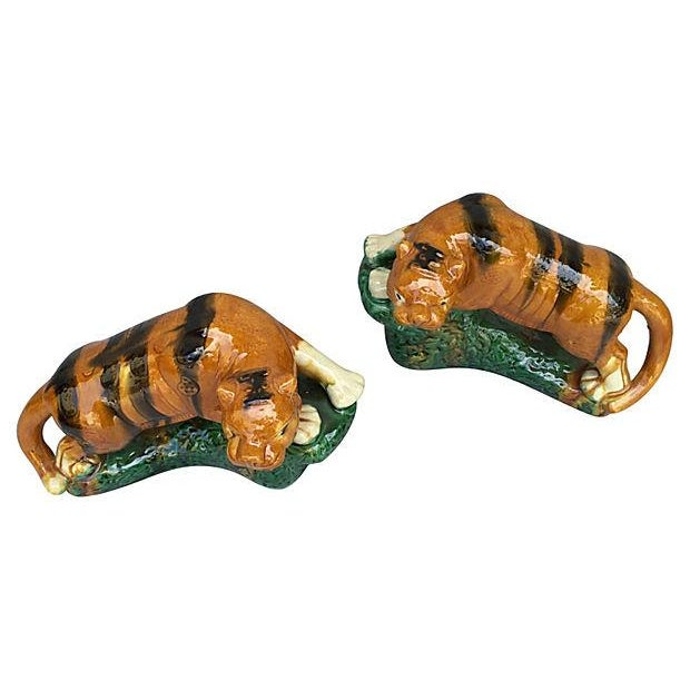 A pair of glazed terracotta tigers made by the Yao hill tribe of Hunan province. Measurements on one tiger. Minor wear...