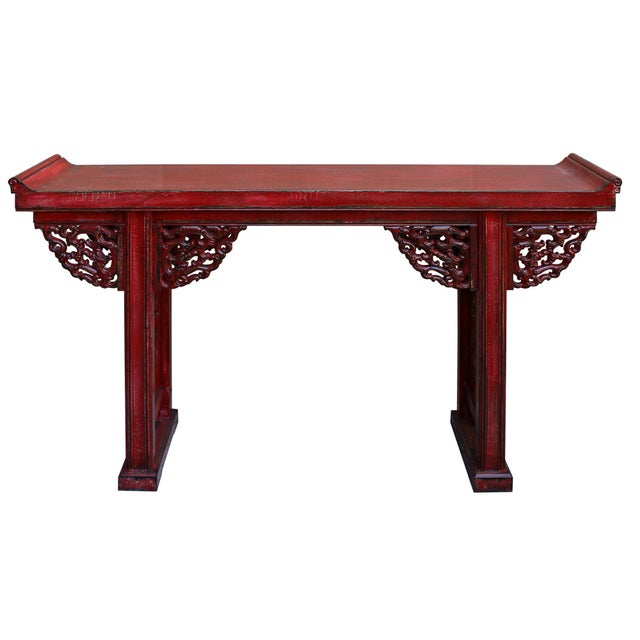 This is a console altar table in distressed red lacquer color .The apron is decorated with oriental Chinese ancient dragon...