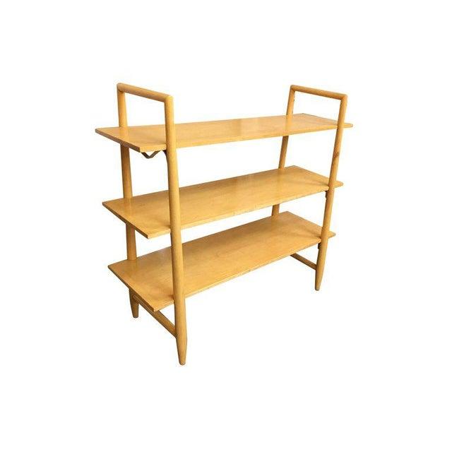 Swedish made blonde Mid-Century Modern bookshelf with three floating shelves designed by Edmond Spence for Walpole....