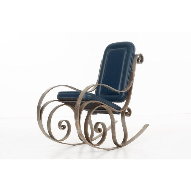 ARTURO PANI (1915 - 1981) Jansen-style 'prototype' leather upholstered rocking chair raised on a hand-forged steel frame....