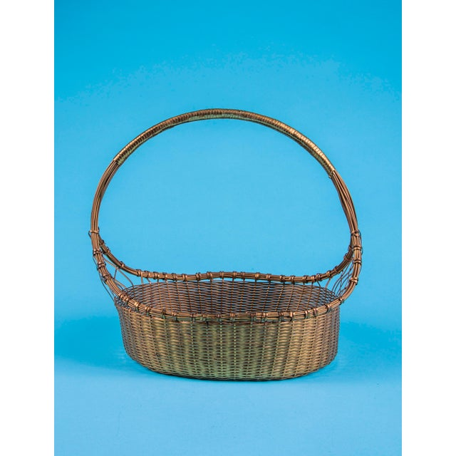 Intricately hand made solid brass woven basket. 1960's vintage, made in India and in very nice cosmetic condition save for...