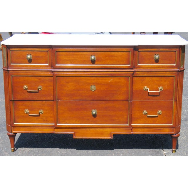 Jansen Louis XV style marbletop commode. ​Brass hardware and mounts marble top. wear to finish.