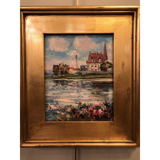 A beautiful oil on canvas impressionistic painting featuring a gorgeous scene of a house surrounded by water and lovely...