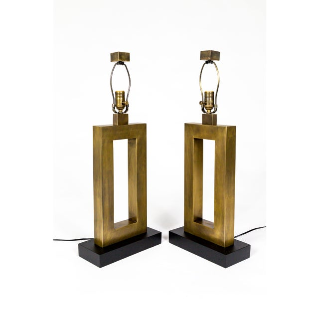 A striking pair of newly restored, 1970's antique brass, rectangular lamps; with amazingly seamless construction and...