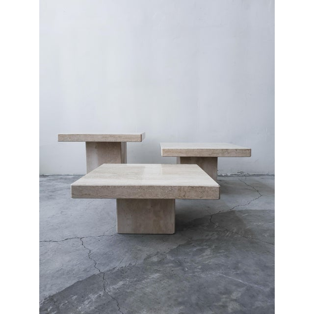 A gorgeous set of three Italian Travertine pedestal style tables of varying heights, . A highly versatile trio, which can...