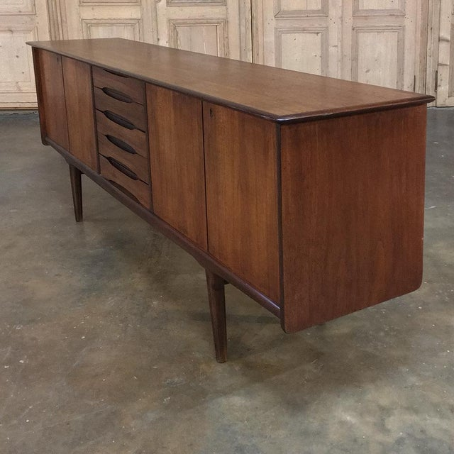 Mid-Century Modern Mahogany Low Buffet is ideal for today's contemporary decors, and is excellent for placing under a...