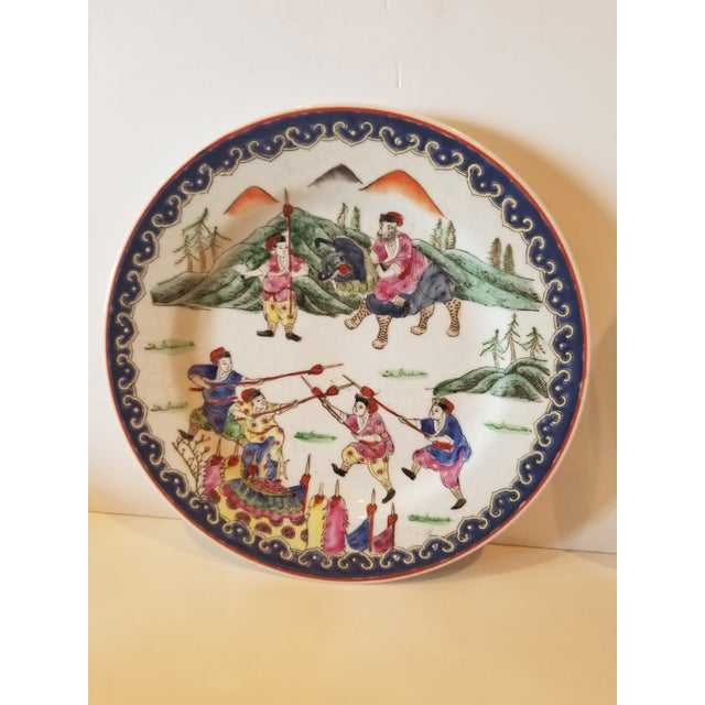 Highly decorative pair of colorful Chinese Export Porcelain Plates or Chargers....great colors and lots of figures.