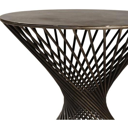 Industrial iron twist side table with a blackened gunmetal iron finish. This is a great unique side table for any...