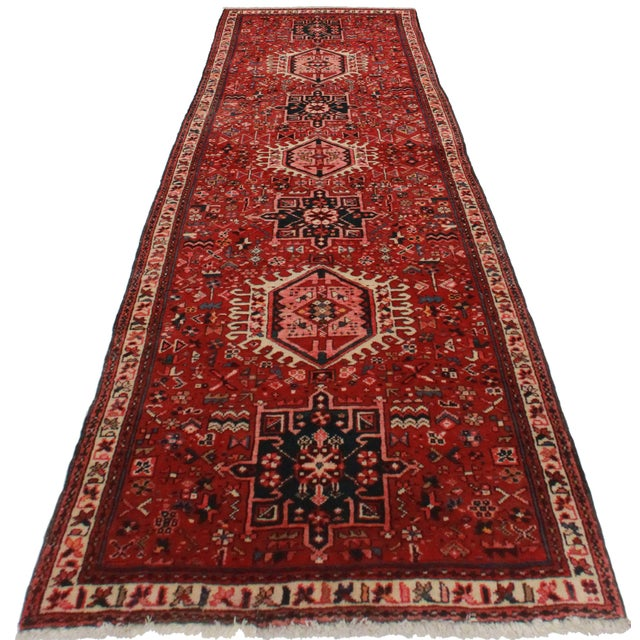 Antique hand knotted wool Persian Hariz runner with a beautiful geometric design.