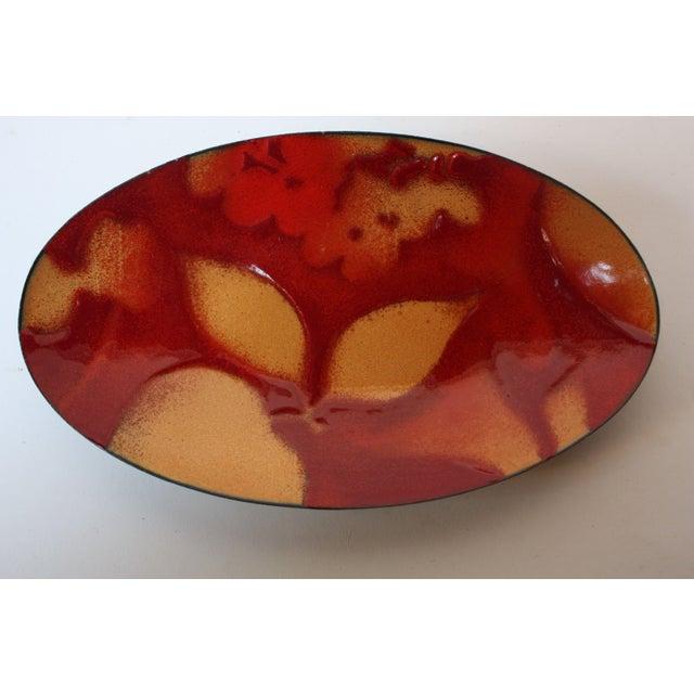 Cameron Tucker and Tara Mackintosh, a husband and wife artistic duo, create beautiful works of enamel in their...