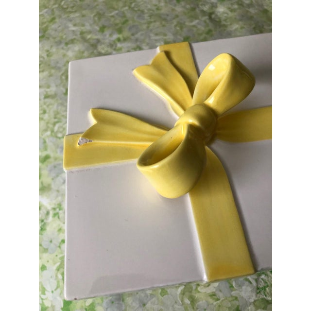 "White ceramic box with yellow bow (chip on bow) 5.5"" square x 5""H."