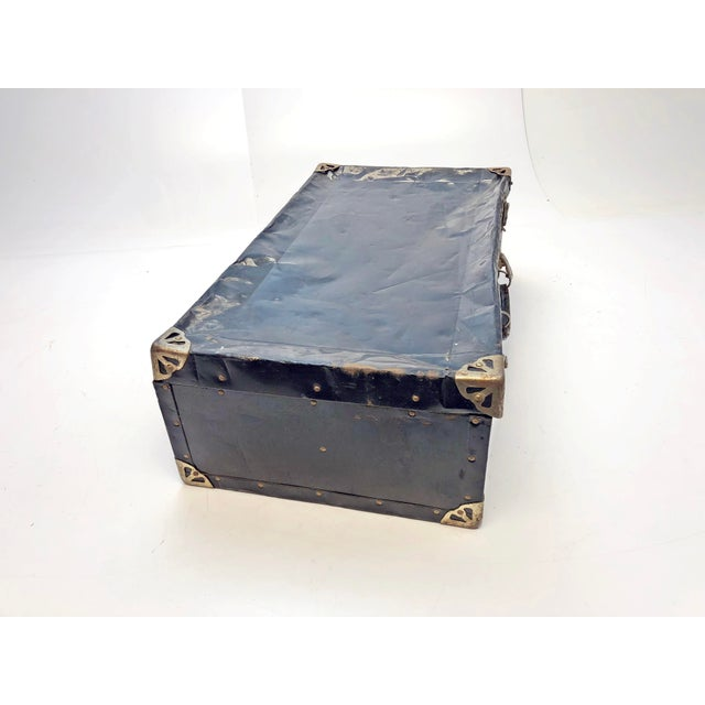 Vintage Metal Trunk. Neat solid metal with steel corners and accents. Leather handle on top is working. Two clasp hardware...