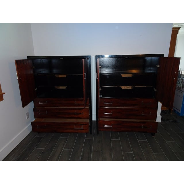 These vintage John Stuart Highboy dressers have Rosewood doors with satin black lacquer frames and satin nickel pulls....