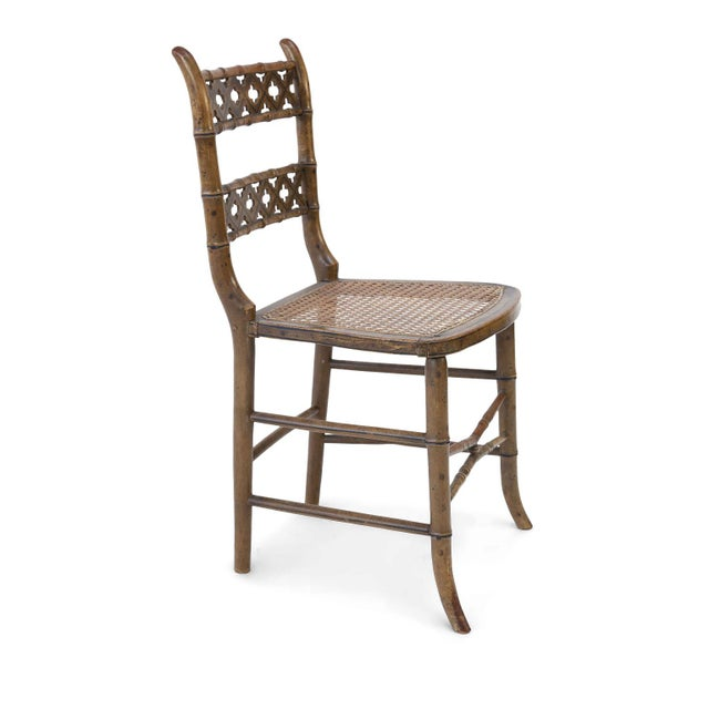 Pair of Regency faux bamboo chairs in original paint. Hand-carved (circa 1810-1830) with quatrefoil and painted line...
