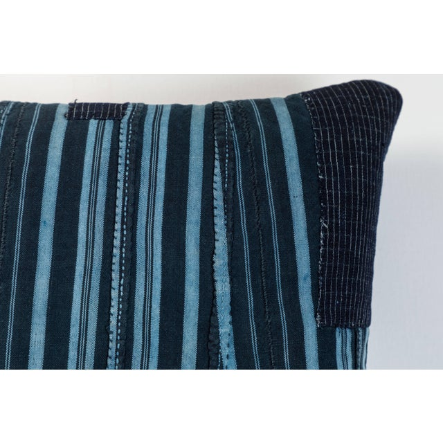 Pillow made using vintage Ashante textile. Handwoven in Nigeria by the Yoruba Tribe. Long strips of cotton hand woven on...