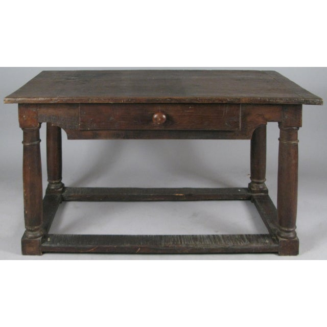 A Classic antique walnut 18th century Italian table with a single center drawer and column legs. handsome scale and...