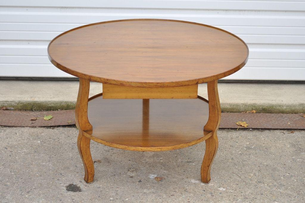 Item: Vintage Custom Quality French Country Style Solid Wood Round  Occasional Coffee Table. The