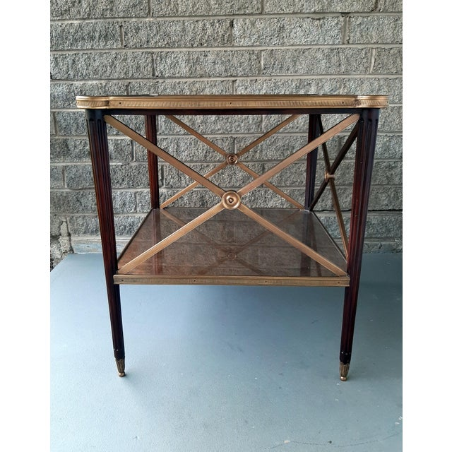 Item offered is a Theodore Alexander Eglomise Collection End Table/Lamp Table. It has a walnut frame with fluted walnut...