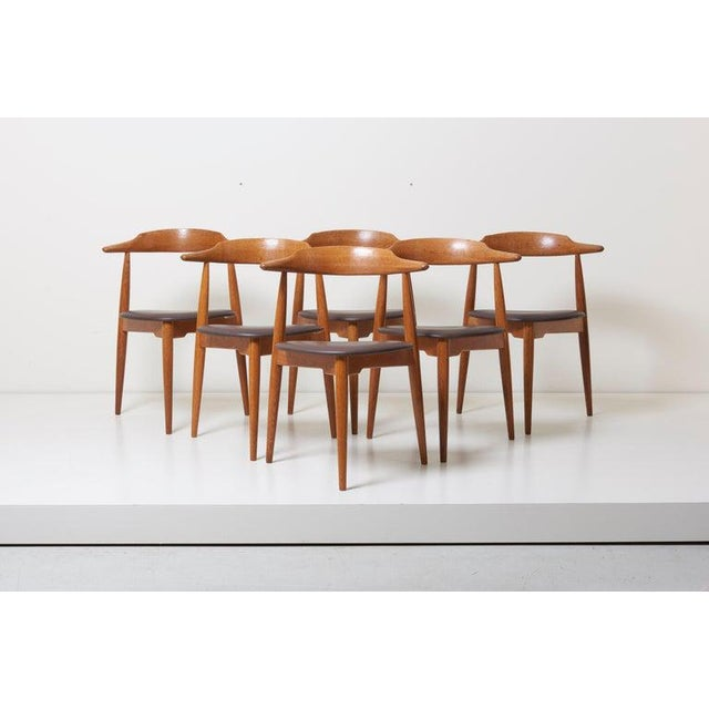 Lovely dining set with a round three leg table and six three leg heart chairs FH 4103 by Hans Wegner in 1950s for Fritz...